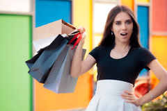 Surprised Girl Shopping on Big Summer Sale royalty free stock photography