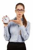 Surprised girl shows the alarm clock Stock Images