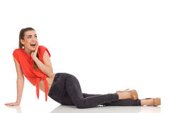 Surprised girl sitting on the floor Stock Images