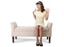Surprised Girl Sitting and Waiting. Stylish retro female sitting on a chaise lounge or sofa on white background Stock Image