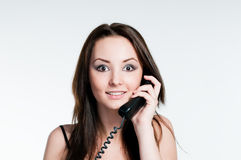 Surprised girl speaking on phone Stock Images