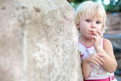 Surprised girl by the stone Royalty Free Stock Photo