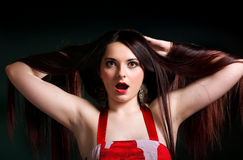 Surprised girl straight long hair. Surprised young woman straight long dark hair make up dark background Stock Photos