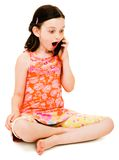 Surprised girl talking on mobile Royalty Free Stock Image