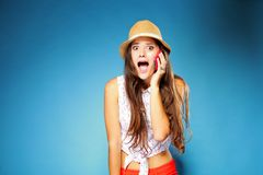Surprised girl talking on mobile phone Stock Photography