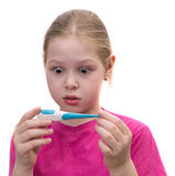 Surprised girl with a thermometer. Isolated on white Royalty Free Stock Image