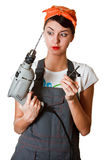 Surprised girl with tools Stock Images