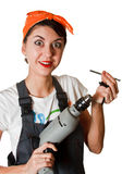 Surprised girl with tools Royalty Free Stock Photo