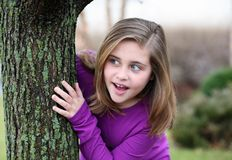 Surprised girl by tree Royalty Free Stock Photos