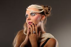 Surprised girl wearing pearls and diamonds Stock Photo