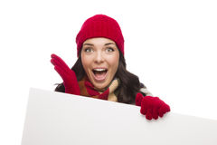 Surprised Girl Wearing Winter Hat and Gloves Holds Blank Sign Stock Images