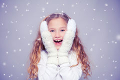 Surprised Girl in winter clothes Stock Photography