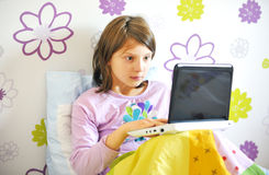 Surprised girl  woman with laptop in her bed Royalty Free Stock Photography