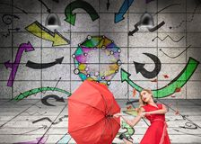 Surprised glamour woman holding a broken umbrella Royalty Free Stock Photo