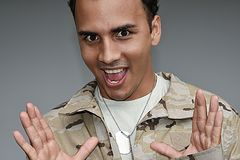 Surprised Good Looking Male Soldier. A handsome young hispanic man Stock Photos