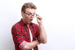 Surprised guy showing wonder Royalty Free Stock Photos