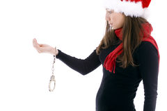 Surprised handcuffed woman in Santa red cap Stock Photography