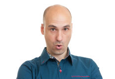 Surprised handsome bald man Stock Photo