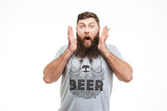 Surprised handsome bearded man with opened mouth Royalty Free Stock Photography