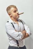 Surprised handsome man smoking cigar Stock Photography