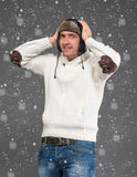 Surprised handsome man in winter hat royalty free stock photography
