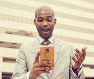 Surprised handsome young man looking at phone Royalty Free Stock Photo