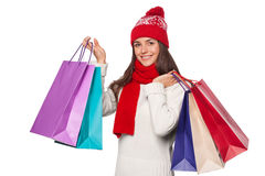 Surprised happy beautiful woman holding shopping bags in excitement. Christmas girl on winter sale, isolated Stock Images