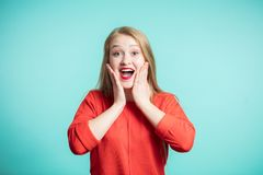 Surprised happy beautiful woman looking at camera. Expressive facial expressions, Emotions, copy space. stock photo