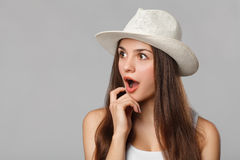 Surprised happy beautiful woman looking sideways in excitemen, isolated on gray background.  Royalty Free Stock Photo