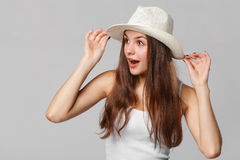 Surprised happy beautiful woman looking sideways in excitement.  on gray background Stock Images