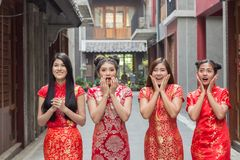 Surprised happy beautiful woman looking up in excitement ,Group of woman wearing cheongsam chainese dress looking something royalty free stock photo
