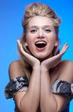 Surprised happy blonde girl. Portrait of beautiful surprised happy blonde girl Stock Images