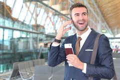 Surprised and happy businessman at the airport royalty free stock image