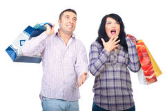 Surprised happy couple with shopping bags Royalty Free Stock Images
