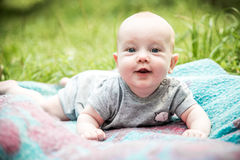Surprised happy expression baby looking to camera. Surprised expression baby outdoors in summer Stock Images