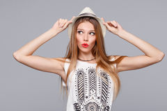 Surprised happy young woman looking sideways in excitement. Isolated over gray Stock Images