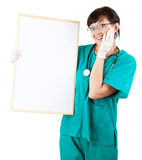 Surprised health care worker woman and empty sign Stock Photo