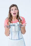 Surprised hipster woman holding pressure cooker Royalty Free Stock Photography