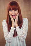 Surprised hipster woman posing face to the camera Royalty Free Stock Images