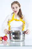 Surprised homemaker in kitchen Royalty Free Stock Image