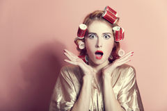 Surprised housewife with curlers Royalty Free Stock Image