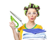 Surprised housewife with iron Stock Image