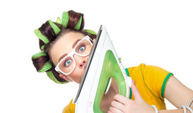 Surprised housewife with iron Royalty Free Stock Image