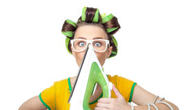 Surprised housewife with iron Royalty Free Stock Images