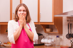 Surprised housewife in kitchen Royalty Free Stock Images