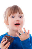 Surprised hungry girl dirty with chocolate cake Royalty Free Stock Images