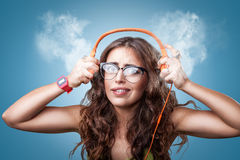 Surprised impressed girl in headphones listening to music. Royalty Free Stock Image
