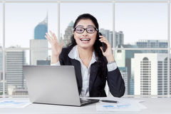 Surprised indian manager listening a phone Stock Image