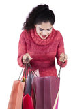 Surprised indian woman opens shopping bags Stock Photos