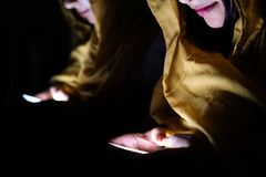 Surprised Indian young woman using smart phone indoor. Surprised young woman using smart phone outdoors Stock Image